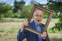 Fun of pensioner with picture frame