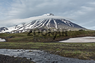 Kamchatka Peninsula landscape: mountain creek and Oval Zimina Volcano