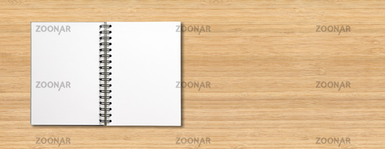 Blank open spiral notebook isolated on wooden banner