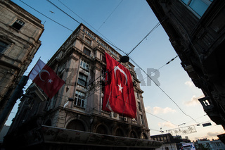 Turkish flag hanging from a European style building in the Beyoglu neighborhood of Istanbul