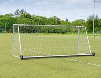 Football playground. Gate with  blue yellow nets, soccer football net.