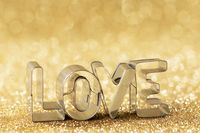 Word LOVE on golden background