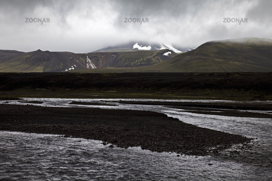 Black lava landscape with the Raudfossakvisl river, Landmannaleid, Fjallabak, Iceland, Europe