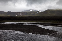 Black lava landscape with the Raudfossakvisl river, Landmannaleid, Fjallabak, Iceland, Europe