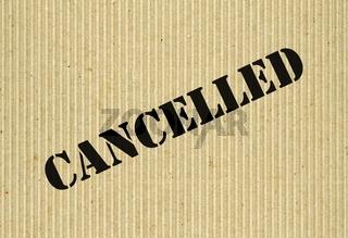 Cancelled on cardboard