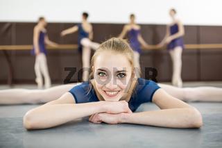 ballerina sitting on the floor