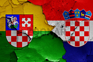 flags of Bjelovar-Bilogora County and Croatia painted on cracked wall