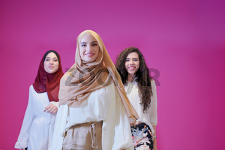 muslim women in fashionable dress isolated on pink