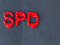 Molten SPD-logo on concrete wall
