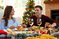 Young couple having christmas dinner together