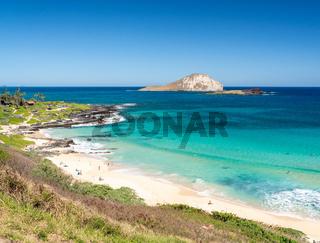 Coastline of East Oahu over Makapuu Beach with Rabbit island