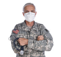 Military Health Care Concept. Military doctor with his arms folded wearing camoflague fatigues, surg