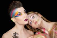 Two attractive young women with creative make-up