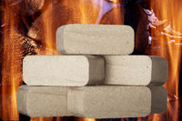 Wood briquette in front of fire