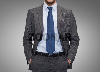 close up of businessman over gray background