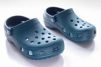 Calgary, Alberta, Canada. Nov. 19, 2020. Front View of Blue Crocs footwear, foam clog shoes on a white background.
