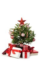 Christmas tree and gifts on white