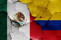 flags of Mexico and Colombia painted on cracked wall