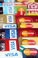 credit cards with VISA and MasterCard brand logos