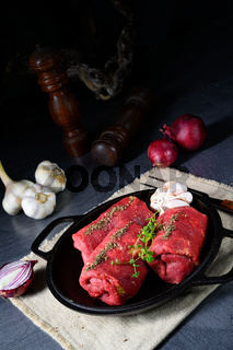 raw beef roulades prepared for cooking