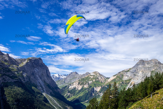 Paragliding over the pralognan mountains in the Vanoise National Park
