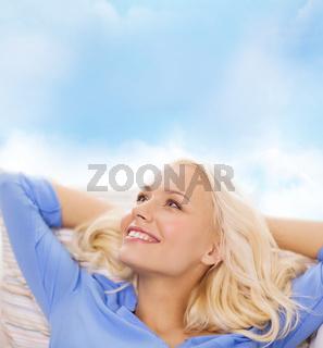smiling young woman lying on sofa