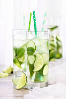 Refreshing  infused  water with cucumber, mint and lime . Summer beverage cocktail lemonade. Healthy