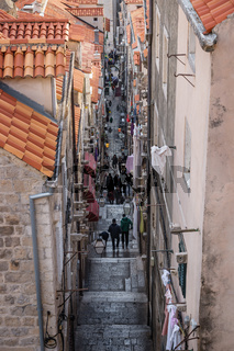 Aerial view of narrow alley in Dubrovnik with tourists, Croatia