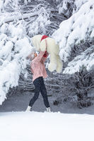 Happy go lucky woman playing in snow
