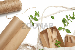 textile bag and disposable tableware from brown craft paper, green mint leaves