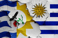 flags of Treinta y Tres Department and Uruguay painted on cracked wall