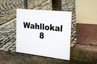 a sign indicates the polling station on election day