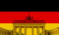 flag of Germany with superimposed Brandenburg Gate in Berlin