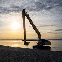 Industrial excavator on lake neusiedlersee working