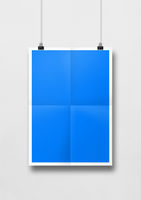 Blue folded poster hanging on a white wall with clips