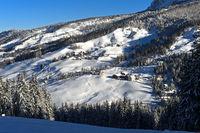 Scenic hamlet in a snow-covered winter landscape near La Villa, Alta Badia, Dolomites, South Tyrol