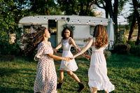 Happy beautiful women dancing outdoors on picnic