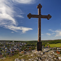 Cross on the Piusberg with a view of the city, Warstein, Sauerland, North Rhine-Westphalia, Germany
