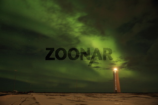 Aurora above the lighthouse on Gardskagi, Keflavik, Iceland