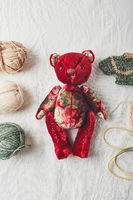 Handmade teddy bear and knitted little sweaters