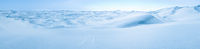 Big snow and ice dunes panorama with tire marks. Arctic Snowball Earth.
