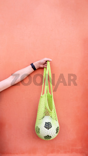 Soccer ball in eco mesh shopping bag
