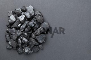 Black Coal Pile Over Black Background
