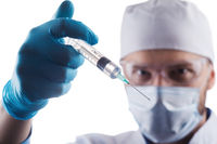 Doctor holding a syringe with vaccine against corona virus.