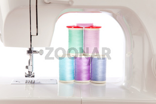 White Sewing Machine and colorful threads