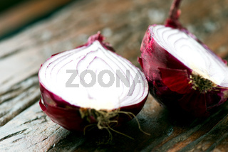 Fresh red onions on an old wooden table horizontal view