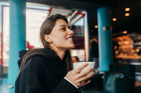 Close up portrait of pretty female drinking coffee.