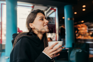 Close up portrait of pretty female drinking coffee.