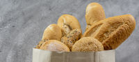 Bread variety in disposalable paper bag. Panoramic