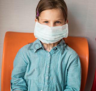 Girl wearing facial disposable mask. Virus protection
